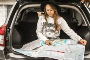 woman-using-map-on-gray-car-compartment-1051078